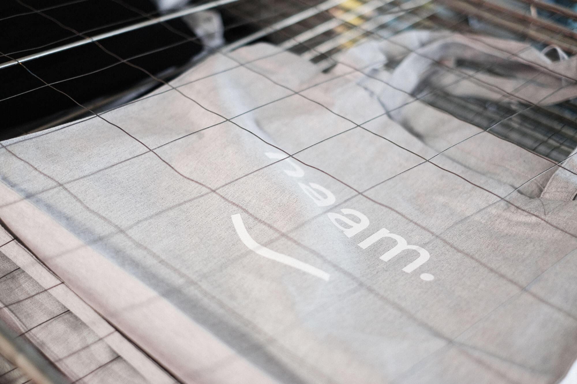Grijze tote tas met wit Studio Naam logo