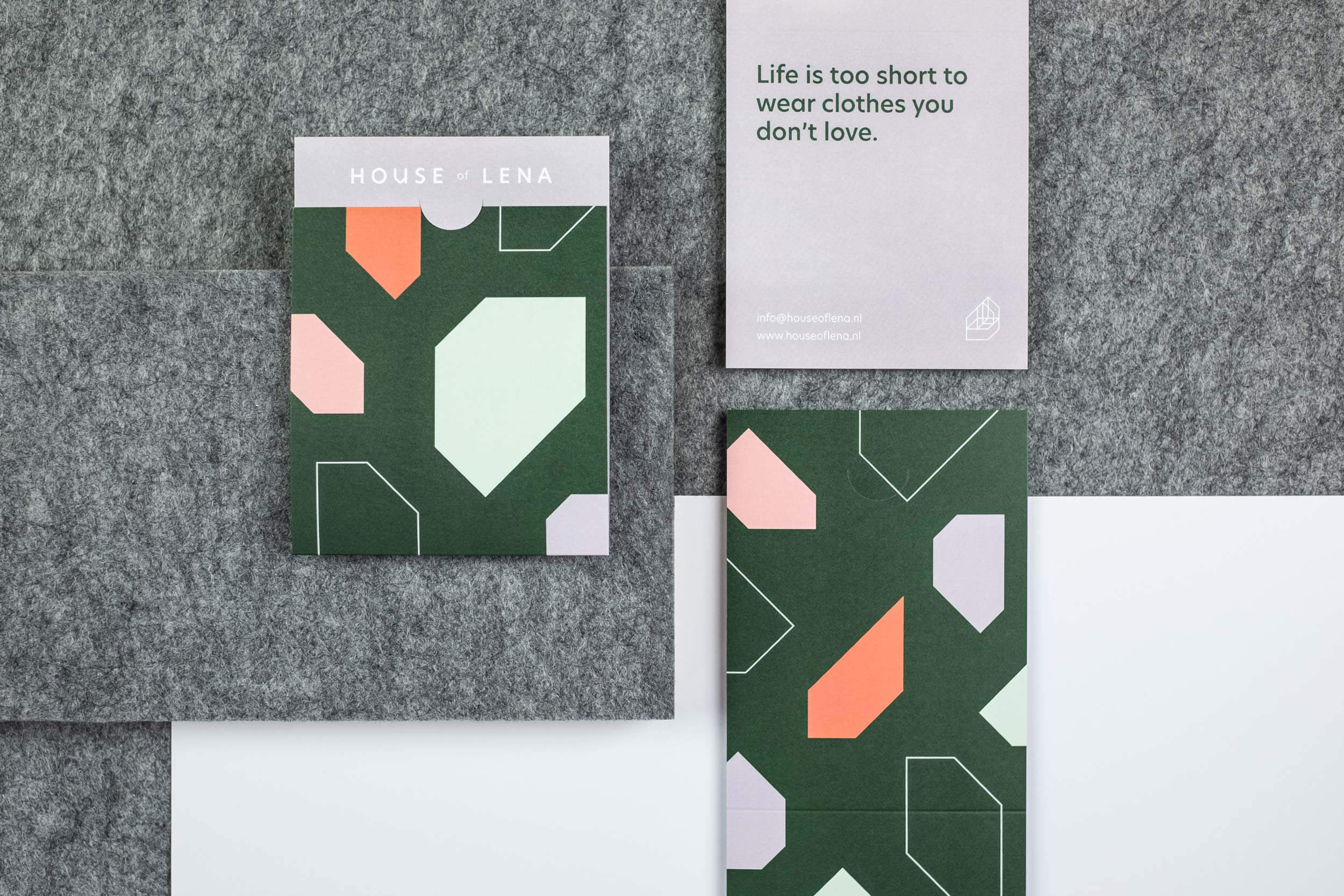 Drie bonnenboekjes van de grafische House of Lena identiteit.